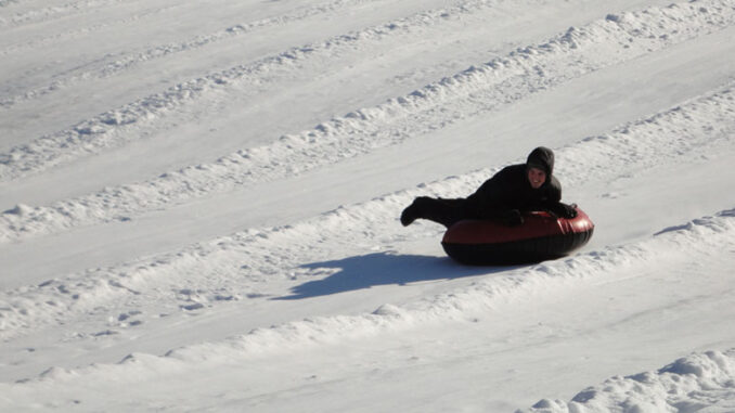 Snow tubing at Four Seasons Golf & Ski Center in Fayetteville. The facility also offers skiing, snowboarding and tubing, making it a good place to go for families that want a variety of winter recreation. Photo provided