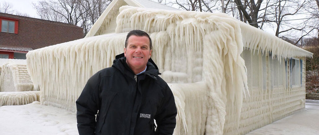 John Kucko stands by a frozen building in Webster near Lake Ontario. Courtesy of John Kucko.