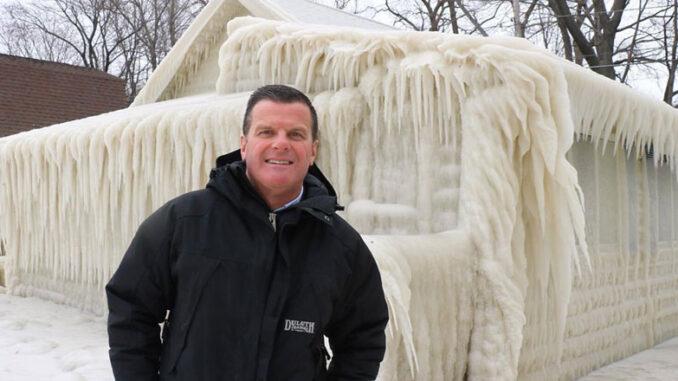 John Kucko stands by a frozen building in Webster near Lake Ontario. Courtesy of John Kucko.